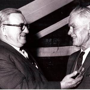 David John Harvey (right) with medal