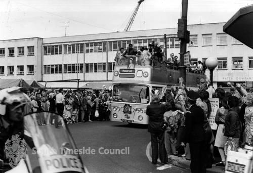 Muhammad Ali in the open top bus