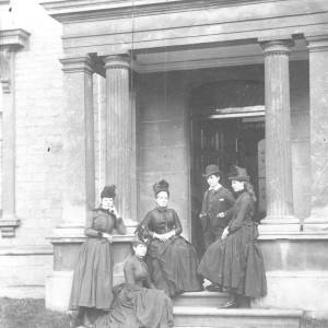 A family on the steps of Athelstan Hall, Hereford.