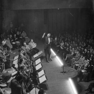 A jazz band in concert, viewed from the wings, 1950s