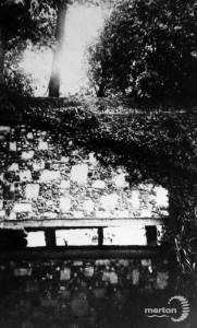 The River Wandle and a surviving section of Merton Priory Wall.