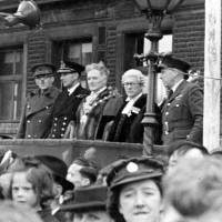 Bootle victory parade, the mayor with Army, Royal Navy, and RAF service chiefs on the dais, 1945