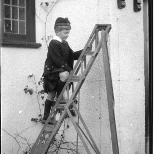 G36-032-07 Young boy in Scottish dress on stepladder.jpg