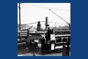 Tram and motorbus passing over Wimbledon Bridge