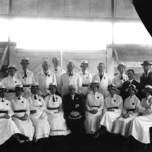 G36-439-12 Group of men and women wearing uniform overalls and hats.jpg