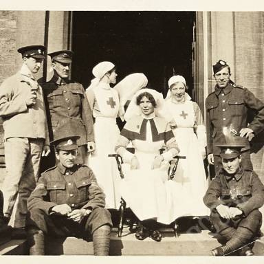 Sister, Nurses and Soldier Patients on Step of Hospital Entrance