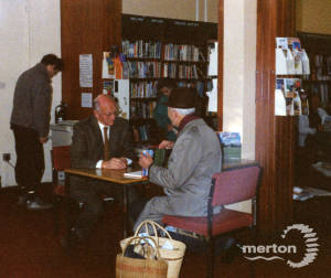 E.N. Montague, signing copies of his book: 'Mitcham Pictorial History'