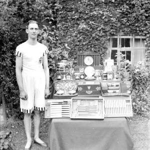 G36-373-01 Sportsman with trophies. Cup reads The Kiralsy Cup'.jpg