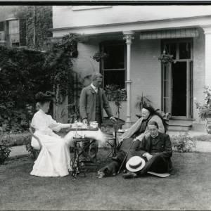 G36-011-02 DuBuisson Family; 31 Castle Street, Hereford; Family group taking tea in Garden.jpg