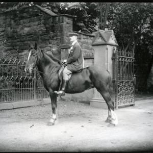 G36-012-13 Man on horse outside Bishops Palace gates.jpg
