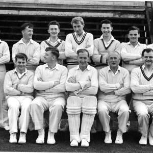 Cricket team plus umpire.