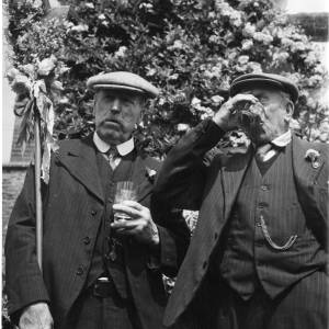 Two Fownhope characters enjoying a glass of beer at the Heart of Oak Club Walk, 1960s