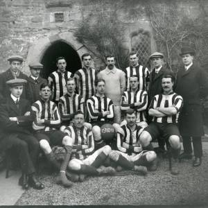 G36-205-01 Football team outside Coningsby Hospital .jpg
