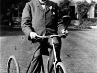 Sidney Gedge M. P. on a tricycle at Mitcham Hall