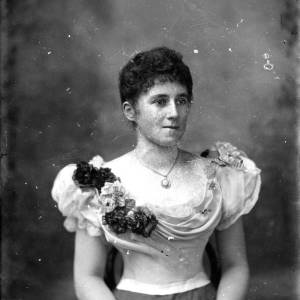 G36-547-04  Lady in evening dress, corsage of flowers on her shoulder.jpg