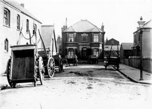Garfield Road, Wimbledon, No. 10: Carts belonging to P.Bell