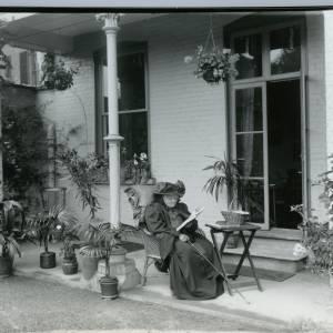 G36-011-11 DuBuisson Family; 31 Castle St Hereford; Old lady reading on verandah.jpg