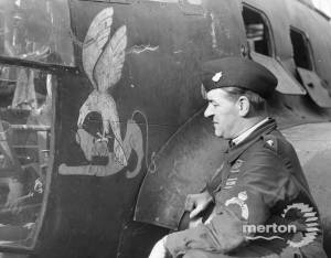 An ARP warden inspects the emblem on a grounded Heinkel bomber
