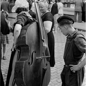 "149 - Woman carrying double bass ""Some fiddle"""
