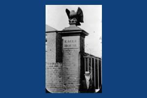 Eagle House, London Road: Stone eagle and brick pillar
