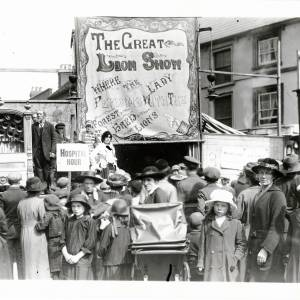 Crowds gather in front of the Great Lion Show, May Fair, Hereford c.1920