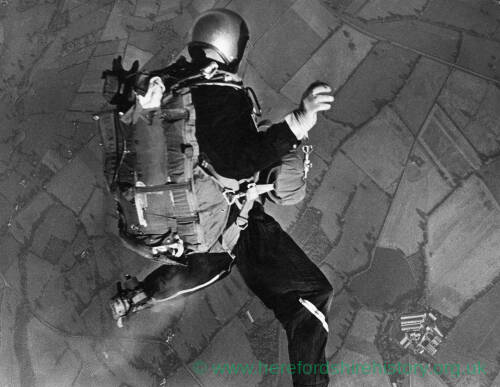 """096 - Parachutist over rural countryside """"Going down!"""""""
