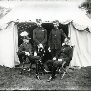 G36-028-02 Four uniformed officers in front of tent, one wearing plumed helmet .jpg
