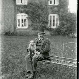 G36-019-10 Man seated with dog on garden bench.jpg