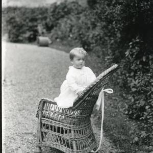 G36-026-07 Toddler standing on wicker chair. Tied safely.jpg