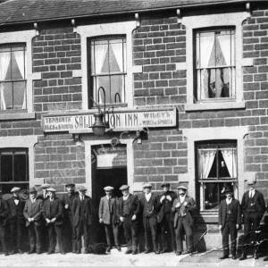 The Salutation Inn, High Green with  a group of men stood outside c. 1920.