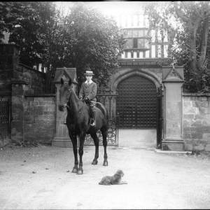 G36-241-11 Boy on horseback outside Bishop's Palace gates.jpg