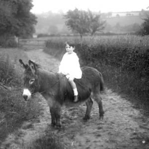 G36-133-15 Little boy on a donkey.jpg