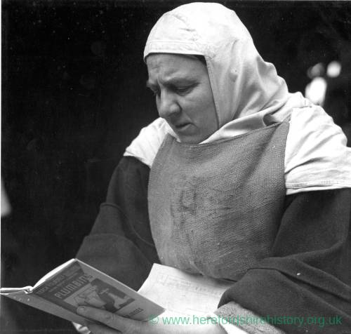 A nun from the Carmelite Order of Presteign reading a plumbing manual