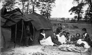 Gypsy family and their Bender tent on Mitcham Common