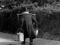 Milkman carrying pails using yokes, Mitcham