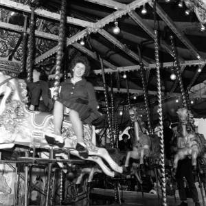 A Woman rides the Carousel at Hereford May Fair, 1965