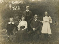The Wright Family in the gardens of Morris & Co.