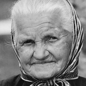 334 - Old woman in head scarf