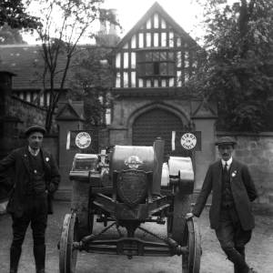 G36-546-06 Two men with champion Overtime tractor outside Bishops Palace.jpg