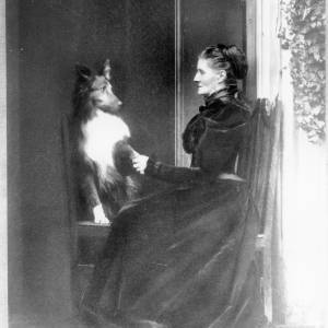 G36-229-11 Portrait of seated lady, holding the paw of a dog, also seated (Copy of negative).jpg