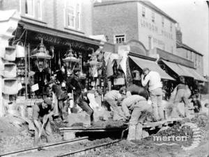 Building the tramway in front of London House, Mitcham