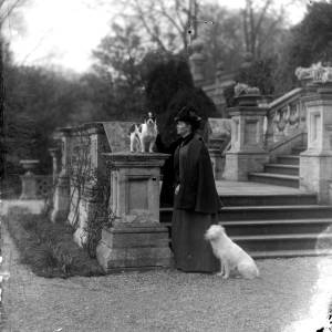 G36-327-14 Lady with two dogs at foot of stone steps.jpg