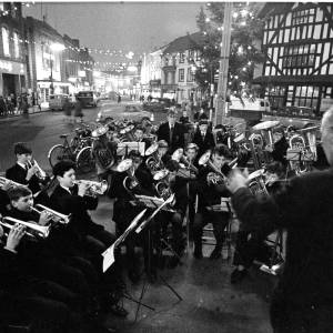 A brass band playing near the Black and White House in Hereford during the Christmas period