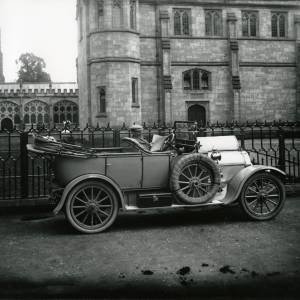 G36-012-04 Man in motor car  outside cathedral .jpg