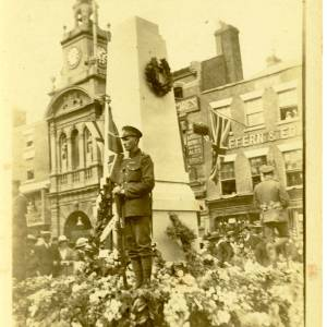 Soldier stands at memorial, High Town, Hereford