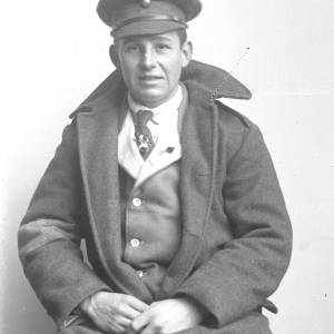 Soldier sitting, possibly Grenadier Guards