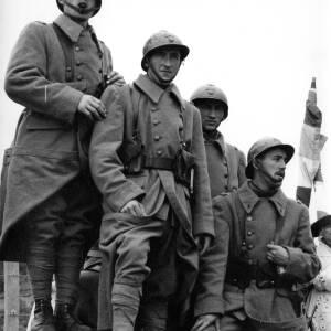 Four men in period battledress.