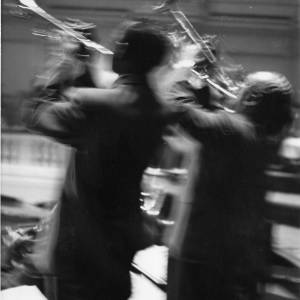 A motion shot of two trumpeters performing, 1950s