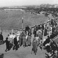 Southport, people promenading, by Marine lake