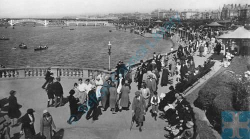 Southport, people promenading, by Marine lake